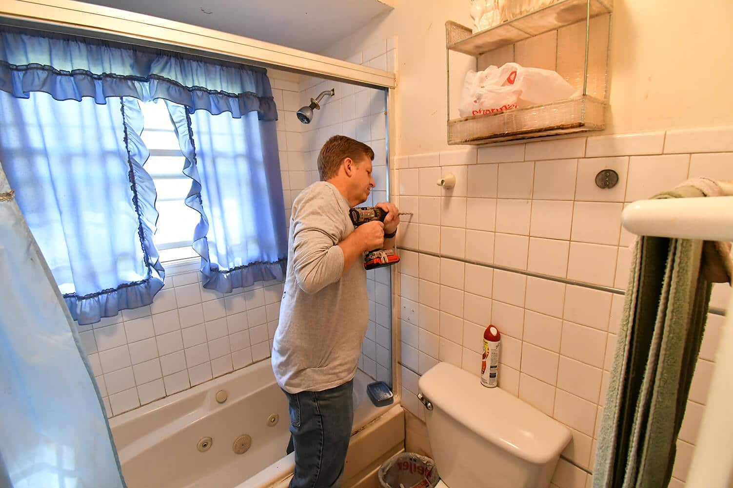 Man fixing a bathroom with the Safe at Home program