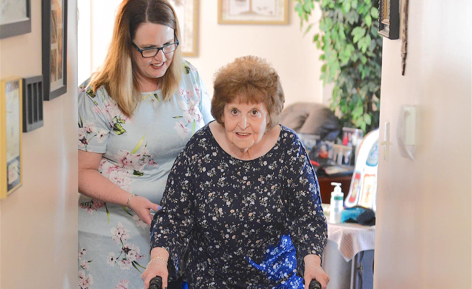 Caregiver helping older lady in her home