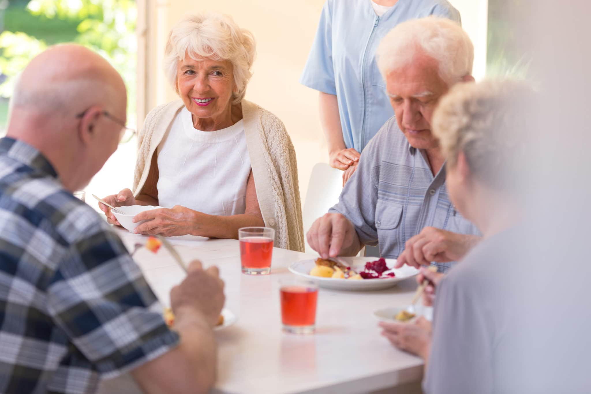 seniors eating at hospital cafeteria