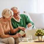 Older couple working on taxes together