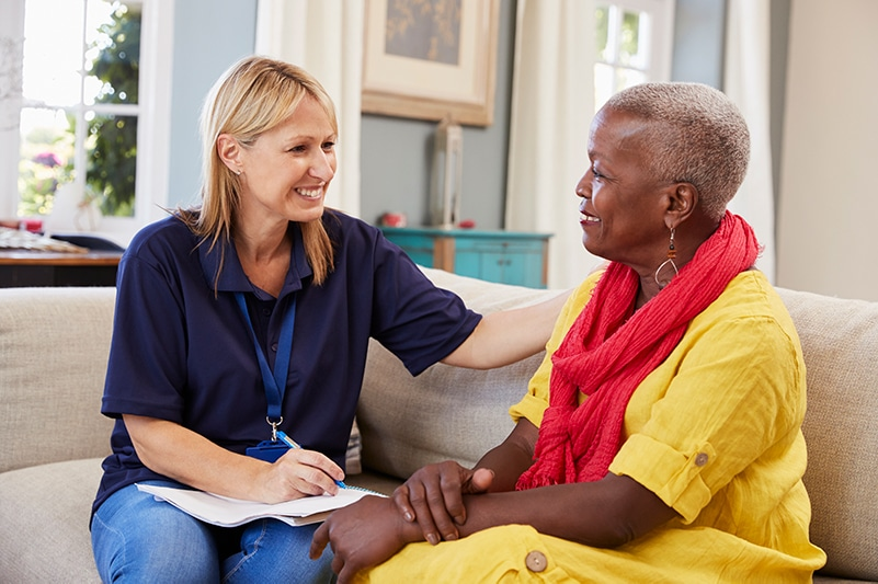 Person-centered care social worker with senior woman