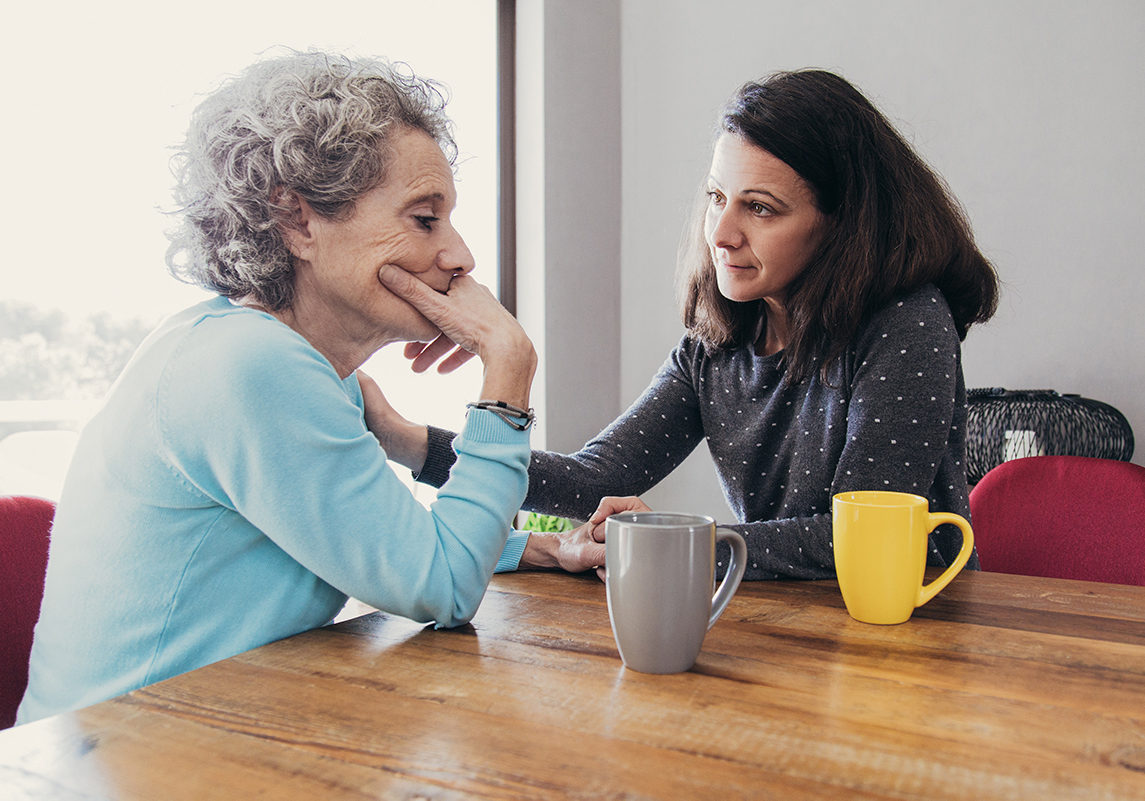Daughter Having Serious Conversation with Senior Mother