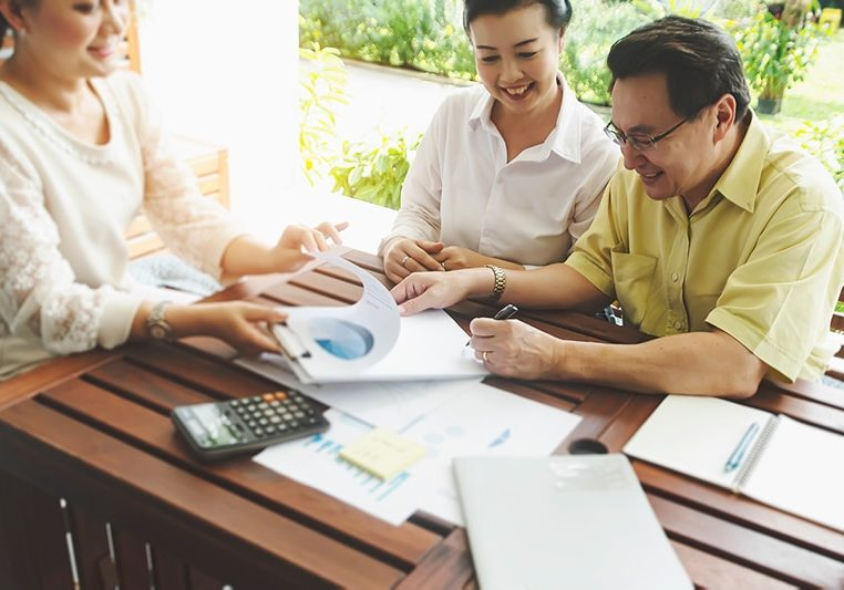 Senior couple meeting with advisor to sell business